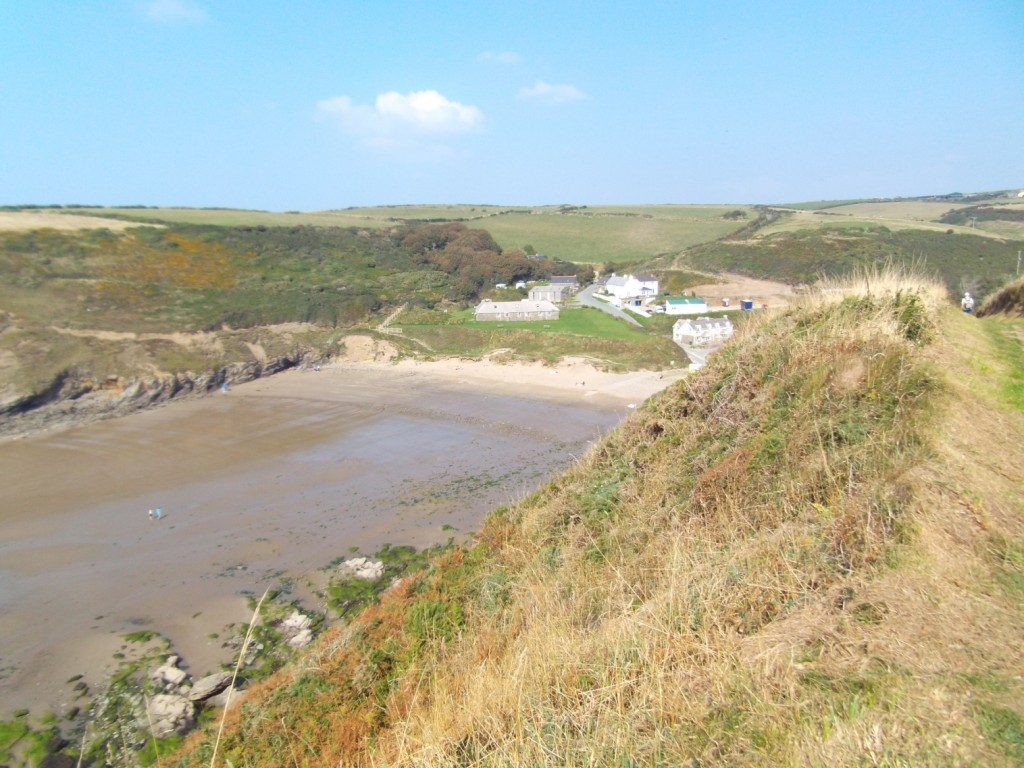 View of Nolton Haven beach and village from the coast path