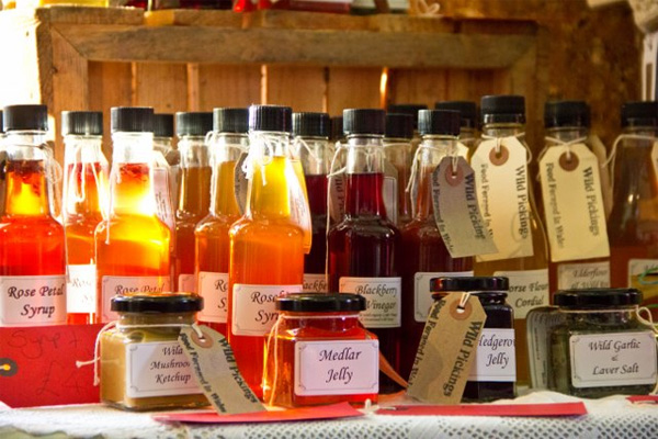 Bottles and jars of preserves, syrups and vinegars