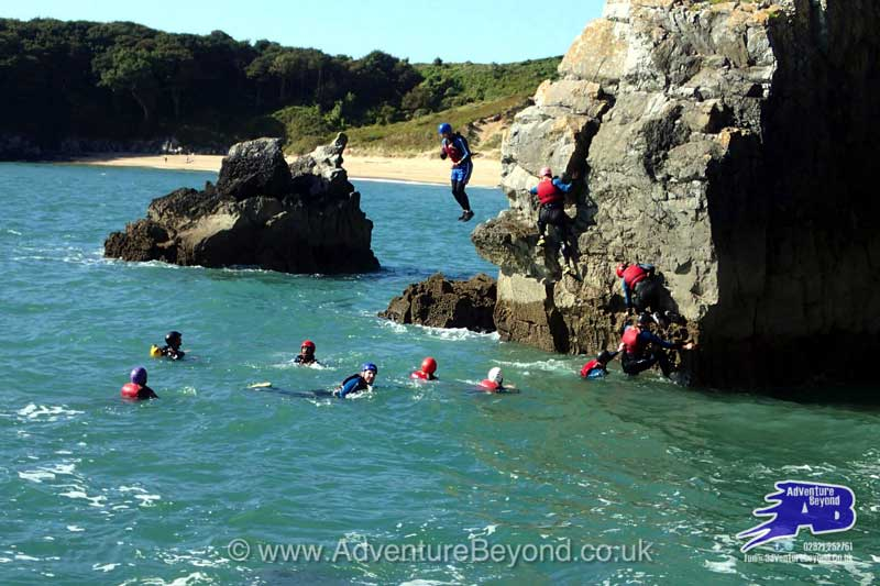 Jumping into the sea from the rocks with Adventure Beyond