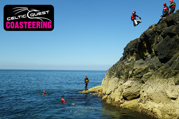 Jumping off coastal cliff in Pembrokeshire with Celtic Quest Coasteering