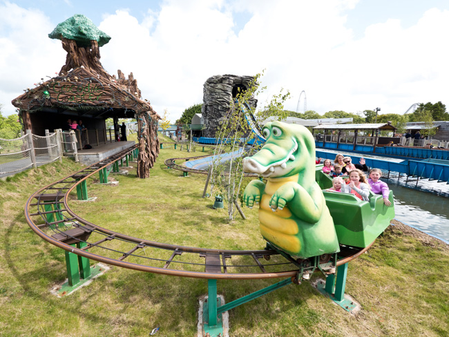 Children on the Croc Coaster ride in Oakwood's Neverland