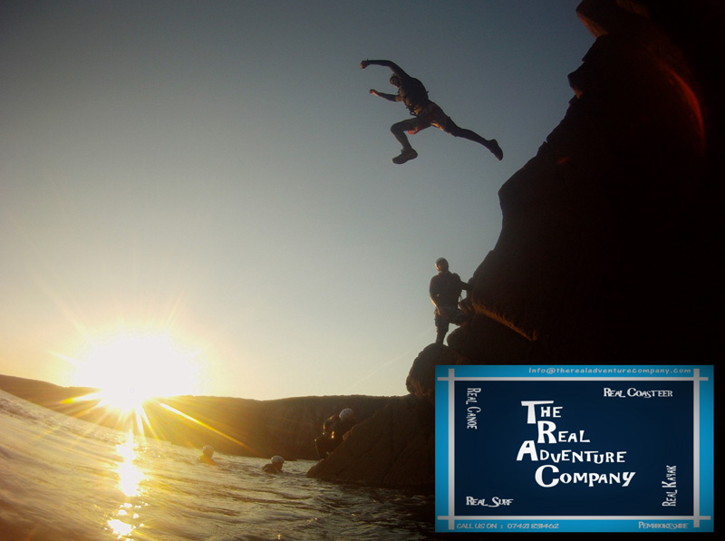 Leaping from a cliff into the sea when coasteering with The Real Adventure Company
