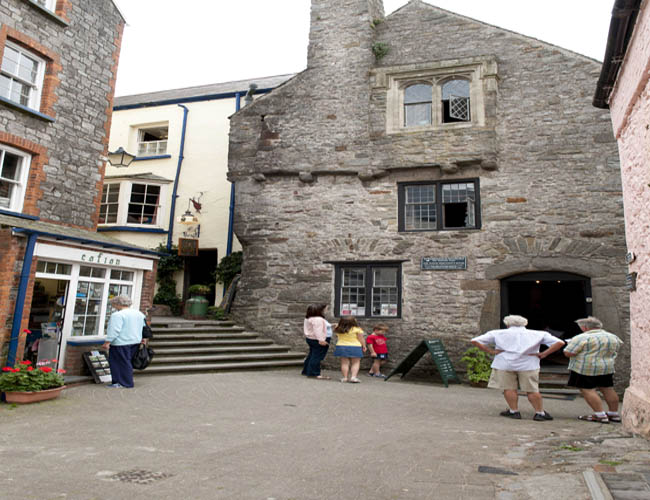 Tudor Merchant's House, Tenby with people stood outside in a narrow street