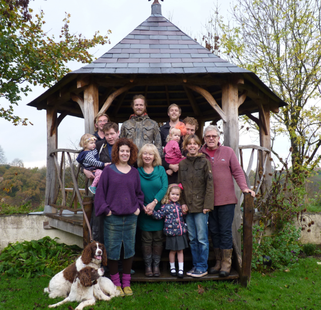 The family team who run the Ceridwen Centre, including children and dogs