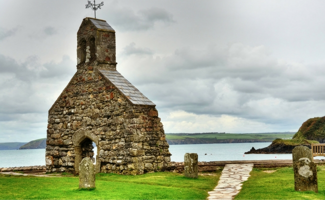 the church ruins at Cwy yr Eglwys, Pembrokeagire with a backdrop of the sea and countryside the other side.