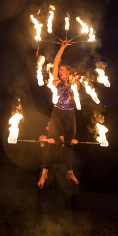 a woman on a pole flame throwing