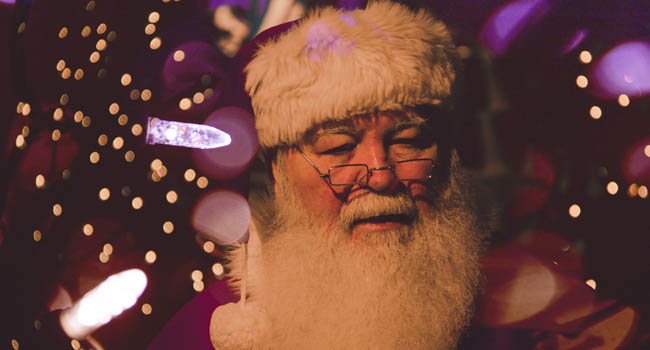 Father Christmas surrounded by lights