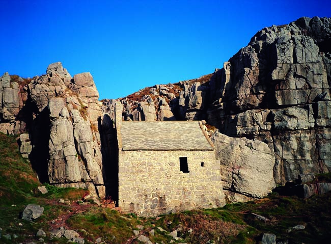 St. Govan's Chapel below tall rocks