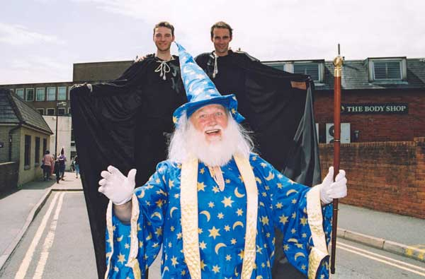 A person dressed up as Merlin the wizzard